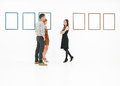 People talking in a museum young caucasian standing white room with empty frames displayed on walls Stock Images