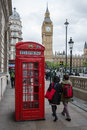 People and telephone booth near Big Ben in London, UK Royalty Free Stock Photo
