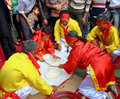 People in traditional costume exam to make round sticky rice cak hai duong vietnam february cake at con son kiep bac festival on Stock Photo