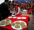 People in traditional costume exam to make round sticky rice cak hai duong vietnam february cake at con son kiep bac festival on Stock Images