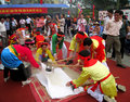 People in traditional costume exam to make round sticky rice cak hai duong vietnam february cake at con son kiep bac festival on Royalty Free Stock Image