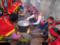 People in traditional costume exam to make round sticky rice cak hai duong vietnam march cake at cao temple festival on march hai Stock Image