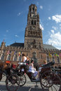 People on a traditional horse horse carriage in bruges belgium august unidentified the square of the city hall belgium Stock Photography
