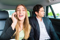People traveling in taxi they have an appointment young businesspeople she is busy on the phone are colleagues Stock Image