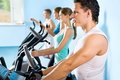 People on the treadmill fitness young attractive Stock Photo