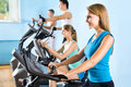 People on the treadmill fitness young attractive Stock Photography