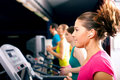 People on treadmill in gym running Stock Images