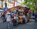 People try on hats at a souvenir stand in Paris