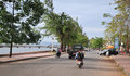 People and vehicles on street in Kep, Cambodia