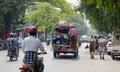 People and vehicles on street in Mandalay, Myanmar