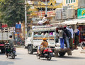 People and vehicles on street in Yangon, Myanmar