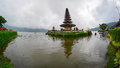 People visit Ulun Danu temple on the lake in Bali, Indonesia Royalty Free Stock Photo
