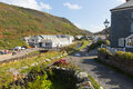 People visiting Boscastle North Cornwall England UK between Bude and Tintagel on a beautiful sunny blue sky day Royalty Free Stock Photo