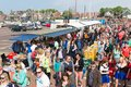 People visiting a fare at a national dutch holiday urk the netherlands apr unknown the harbor of urk on april the netherlands Royalty Free Stock Images