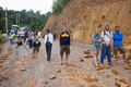 People wait for clearing a road after landslide northern laos august on august in northern laos landslides are common in laos Royalty Free Stock Image