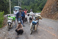 People wait for clearing a road northern laos august after landslide on august in northern laos landslides are common in laos Royalty Free Stock Image