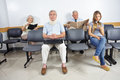 People in waiting room of a hospital different sitting Royalty Free Stock Images
