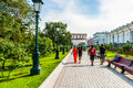 People walk along alexander garden by the moscow kremlin russia on tuesday july central exhibition hall right kutafya tower Royalty Free Stock Image