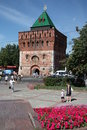 People walk near dmitrovskaya tower nizhny novgorod kremlin of at the minin and pozharsky square russia Stock Image
