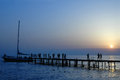 People walk on pier on sunset Royalty Free Stock Photo