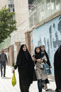 People walking along the former usa embassy photoed by outside wall of in tehran iran work day off and on way home Royalty Free Stock Photography