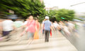 People walking on big city street blurred motion zebra crossing abstract。 Stock Photos