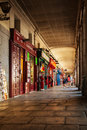 People walking through a corridor of the Plaza Mayor in Madrid Royalty Free Stock Photo
