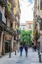 stock image of  People walking down narrow street between shops/stores in Barcelona