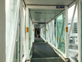 People walking in the gangway at the airport in bali indonesia Royalty Free Stock Photo