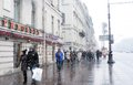 People walking on the nevsky prospect at snowstorm historical city center of saint petersburg russia taken on march in saint Royalty Free Stock Images
