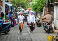 People walking on street in Bali, Indonesia Royalty Free Stock Photo