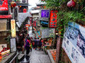 People walking on street in jiufen taiwan also spelled jioufen or chiufen is a mountain area the ruifang district of new Stock Photos
