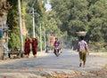 People walking on street at Mingun village in Mandalay, Myanmar