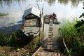 People washing clothes on river hong ngu viet nam november the float with boat beside under sunlight in hong ngu viet nam Stock Photo