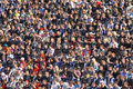 People watch the football game Royalty Free Stock Image