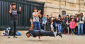 People watch a homeless streetdancer doing breakdance and dance moves in the streets of paris to earn some money mar on Royalty Free Stock Images