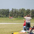 People watch model airplane land radio controlled landing at national aviation day event Royalty Free Stock Photography