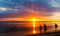 People watching sunset over bali pacific ocean indonesia Stock Image