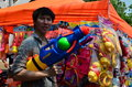 People with water gun for celebrating songkran thai new year water festival chiang mai thailand april in the streets by throwing Royalty Free Stock Image