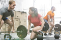 People weightlifting in crossfit gym Royalty Free Stock Photo