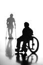 People on wheelchair cardboard silhouettes of with crutches and a Stock Images