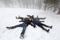 People in winter pelople lying on snow foggy day cyprus mountain troodos Royalty Free Stock Image