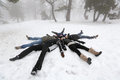 People in winter pelople lying on snow foggy day cyprus mountain troodos Royalty Free Stock Images