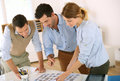 People working in office creative team selecting image shots Royalty Free Stock Image