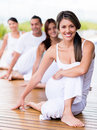 People in a yoga class group of looking very happy Royalty Free Stock Image