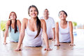 People in a yoga class group of looking very happy Stock Photos