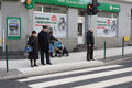 People at a zebra crossing poznan poland january pedestrians waiting on the glogowska street glogowska is one of the main streets Stock Photo