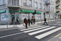 People at a zebra crossing poznan poland january pedestrians walking on red light on the glogowska street glogowska is one of the Royalty Free Stock Image