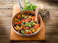 Peperonata over casserole on wood Stock Images
