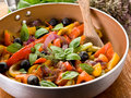 Peperonata over casserole on wood Royalty Free Stock Photos